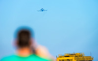 A NASA Ames employee snaps a pic of the Space Shuttle Endeavour Flyover